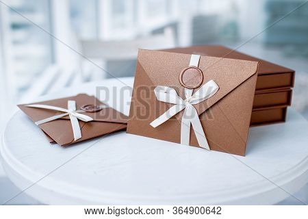 Gift Certificate, Gift Voucher Or Discount. Close-up Photo Of Bronze Invitation Envelope With A Ribb