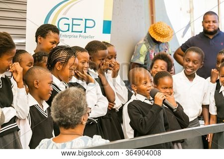 Young African Preschool Kids Singing Songs Outside Local Grocery Shop