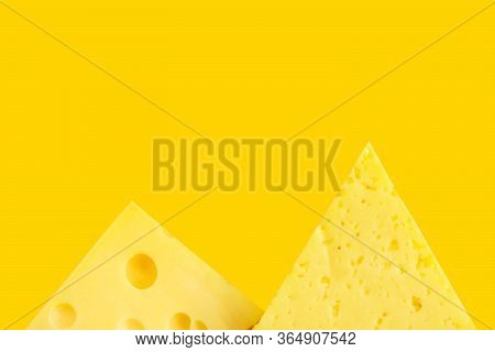 Chunk And Wedge Of Alpine Creamy Tilsit Maasdam Cheese On Yellow Background. Local Delicacy Produce