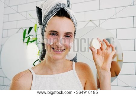 Cheerful Attractive Young Woman Apply Facial Cream Laughing Looking At Camera, Happy Lady Wrap Towel