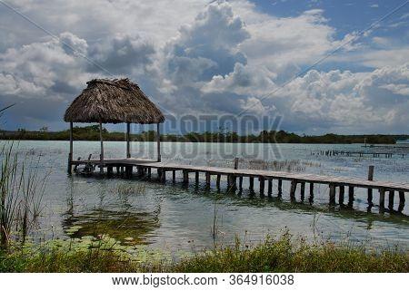 Bacalar Lagoon At Quintana Roo, Mexico. Pier And Palapa On The Lagoon.
