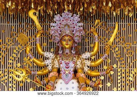 Goddess Durga Idol At Decorated Durga Puja Pandal, Shot At Colored Light, In Kolkata, West Bengal, I