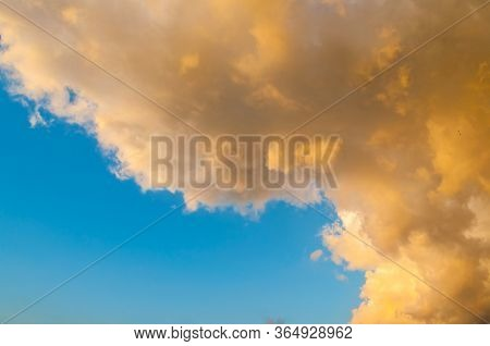 Sunset sky background. Picturesque colorful golden sky clouds lit by evening soft sunlight. Vast sky landscape panoramic scene, sky sunset background. Sky nature, sky landscape, sunny sky view