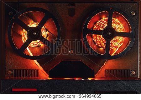 reel-to-reel audio tape recorder with orange led light strip