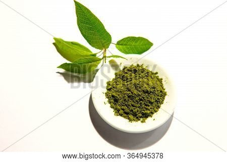 Green Powder Of Japanese Matcha Tea On A Platter, Isolated On A White Background. Loose Powder