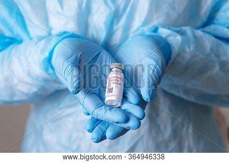 Coronavirus Vaccine. Doctor With A Vaccine. Nurse Holding A Coronavirus Vaccine. Hands Holding A Cor