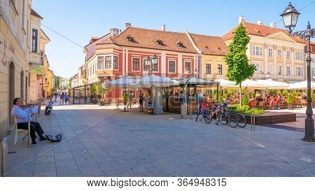 Gyor, Hungary - 02 16 2020: Gypsy Musician Plays The Violin In Gyor In Szechenyi Square.
