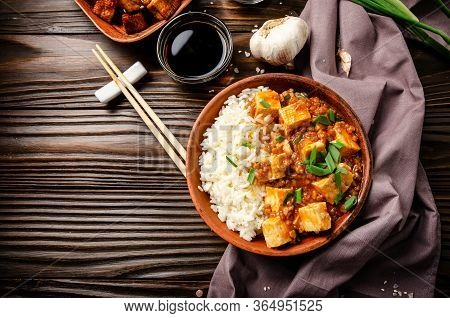 Flat Lay View At Authentic Traditional Chinese Food Mapo Tofu Dish With Pork Chives Steamed Rice And