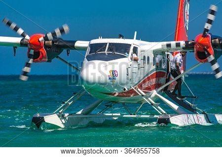 05.24.2019 - Ari Atoll, Maldives: Exotic Scene With Seaplane On Maldives Sea. Amazing Travel Backgro
