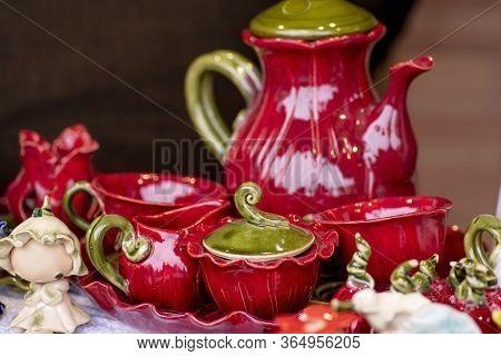 Set Of Clean Dishes And Cups . Porcelain Multi-colored Dishes. Multi-colored Glass Decorative Tablew