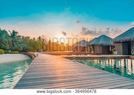 Amazing Sunset Panorama At Maldives. Luxury Resort Villas Seascape With Soft Led Lights Under Colorf