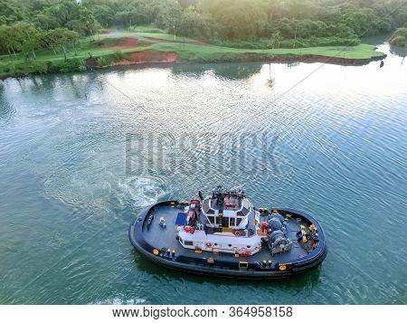 The Patrol Panamanian Tug Boat Guiding Ships Through The Locks.