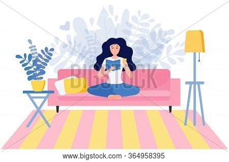 Young Woman Reading A Book Sitting In Yoga Pose On Sofa At Home. Female Character Enjoying A Novel O