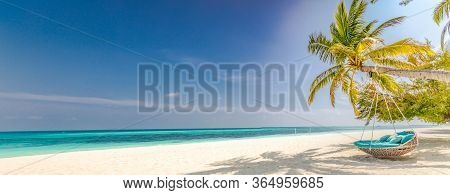 Tropical Beach Panorama As Summer Landscape With Beach Swing Or Hammock And White Sand And Calm Sea