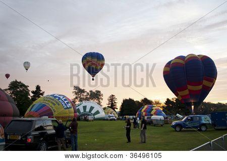 NORTHAMPTON, ENGLAND - AUGUST 18: Hot Air Balloons launching at the Northampton Balloon Festival, on August 18, 2012 in Northampton, England.