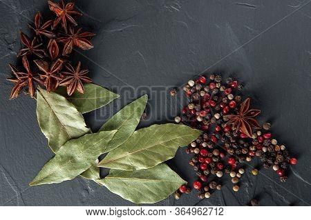 Spices Bay Leaf Badyan And Pepper On A Dark Background
