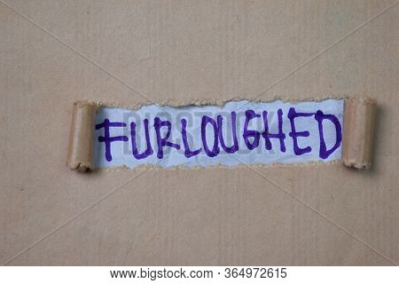 Furloughed Text Written In Torn Paper. Medical Concept