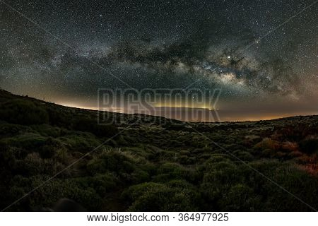 Milky Way In The Spring Sky Above Teide National Park Near Observatory. Jupiter Is Sparkling Surroun
