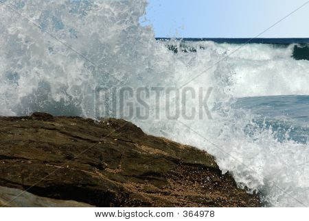 Wave Crashing On The Rocks