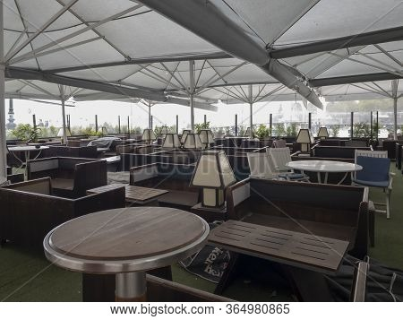 Thessaloniki, Greece - May 6 2020: Empty Outdoors Tables As Coronavirus Measures Affect Business & L