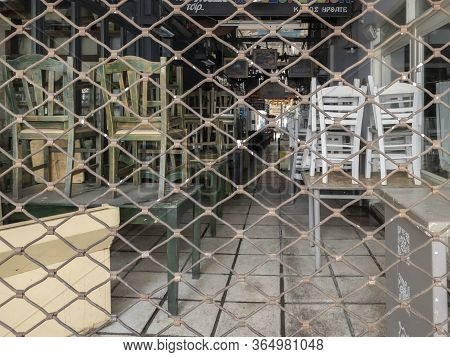 Thessaloniki, Greece - May 6 2020: Empty Indoors Seating Restaurants Affect Business. Closed Taverns
