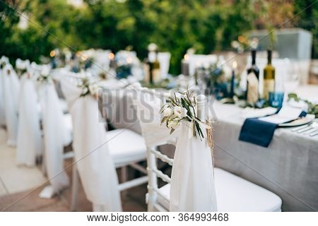 Wedding Dinner Table Reception. White Chair Chiavari Tiffany Decorated With White Delicate Fabric An