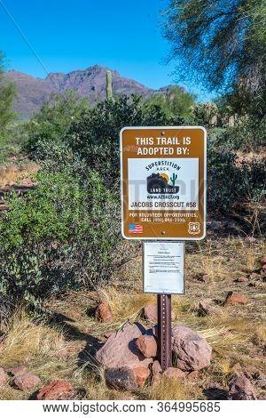 A Description Board For The Trail In Apache Trail, Arizona