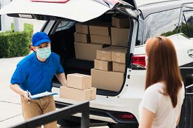 Asian Young Delivery Man Courier Shopping Online Give Parcel Post Box He Protective Face Mask And Se