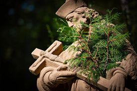 Statue Of Priest In City Park Of Bad Mergentheim. Bavaria, Germany, Europe.