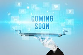 Waiter serving COMING SOON inscription, online shopping concept