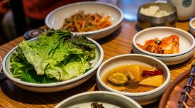 Korean Barbecue Sidedish With Green Lettuce, Pickle And Kimchi.