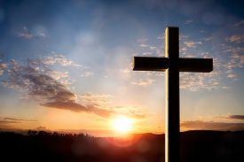 Cross at sunset, crucifixion of Jesus Christ