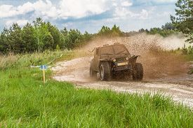 Off-road. The Vehicle Splashing Out The Mud During Off-road Competition