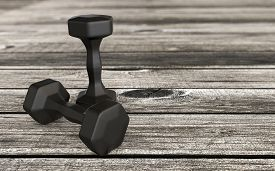 Weight Lifting Concept With Black Rubber Weights On A Wooden Floor With Blurred Background 3d Render