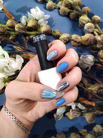 Woman Hand Finger Blue Silver Metallic Holographic Manicure Gel Nail Polish Swatch Design White Bott