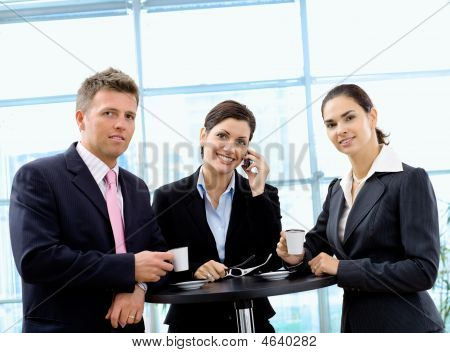 Businesspeople Having Coffee Break