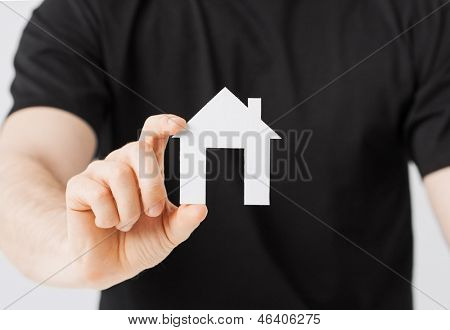 picture of man hand holding paper house