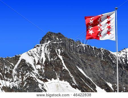 Taschhorn with Wallis flag - Swiss alps