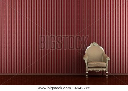 Classic Armchair In Front Of Red Striped Wall