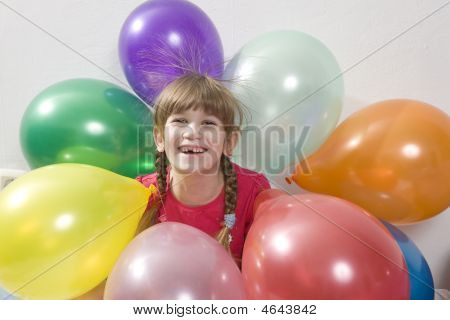 Little Happy Giggle Girl With Balloons