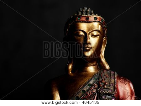 Buddha Statue On Dark Background