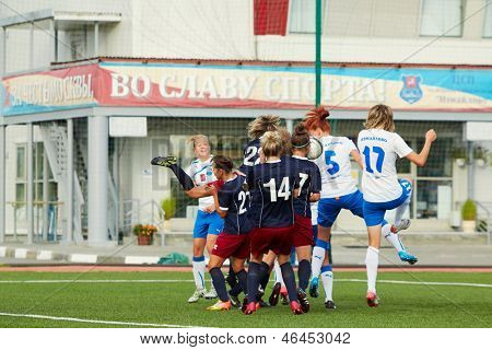 MOSCOW - AUG 23: Struggle for ball on soccer field during match between female teams CSP Izmailovo (Moscow) and Mordovochka (Saransk) at stadium of CSP Izmailovo, August 23, 2012, Moscow, Russia.