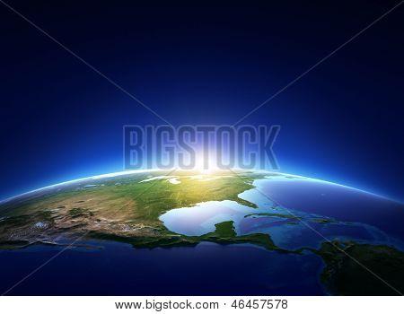 Salida del sol en la tierra sobre América del norte sin nubes (elementos de la imagen proporcionada por la NASA)