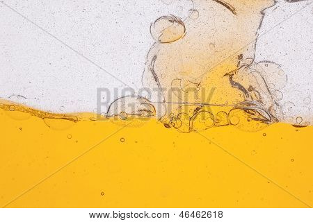Yellow transparent liquid with bubbles isolated on white background poster