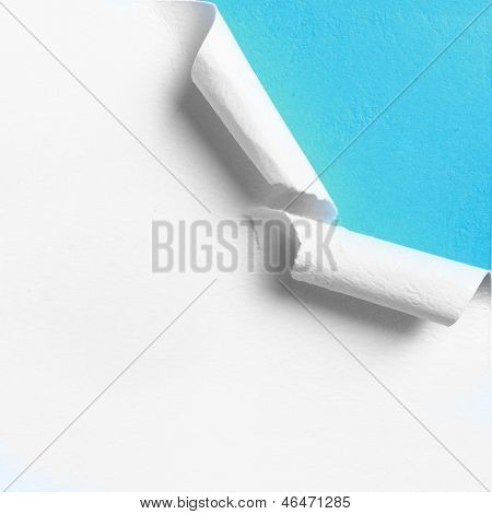 Piece of white paper with torn hole edge over blue background poster