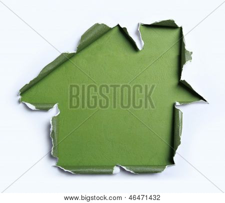white torn paper with house shape over green background poster