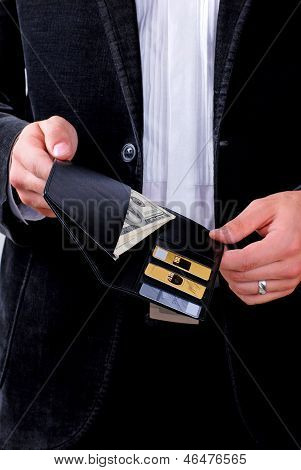 Man With Dollars And Credit Cards