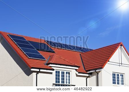 Alternative energy photovoltaic solar panels on tiled house roof poster