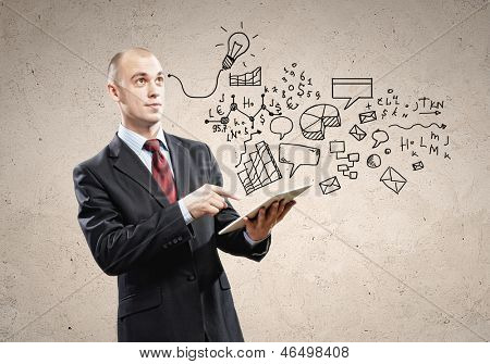 Image of businessman holding ipad in hands