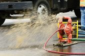 Pumping water out of the exchavation hole to repair a 12 inch water main failure on Harvard Ave in Roseburg OR poster